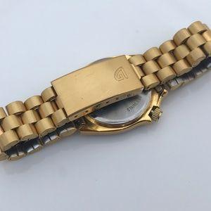 Gruen Accessories - Vintage Gruen Sport Women Watch Gold tone With Day